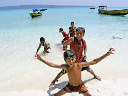 Kids on the beach, Andaman Islands by Doug Anderson 